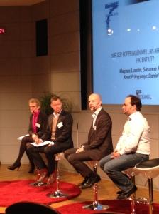 Paneldebatt om kopplingen mellan affärsnytta och patent.
